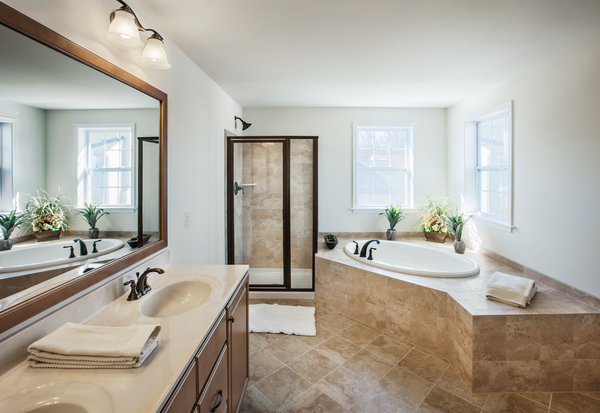 Luxurious primary bedroom suite with well-appointed primary bath