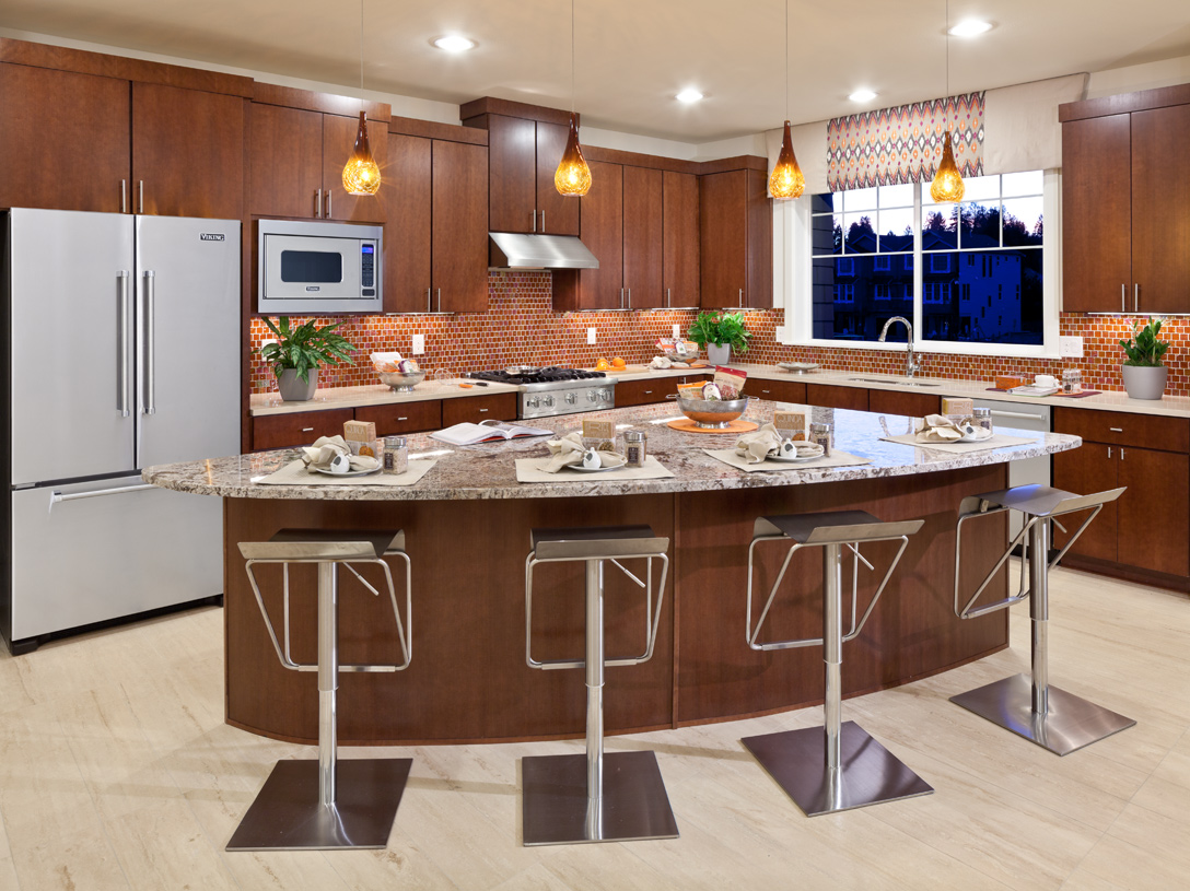 Well designed kitchen offers plenty of cabinet space and large center island