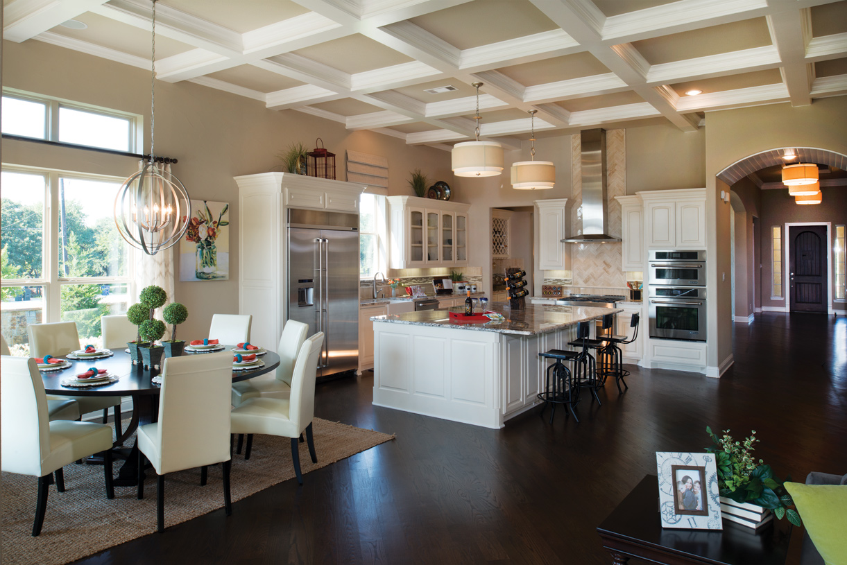 Kitchen features oversized island, walk-in pantry off the butler pantry, and opens to casual dining area