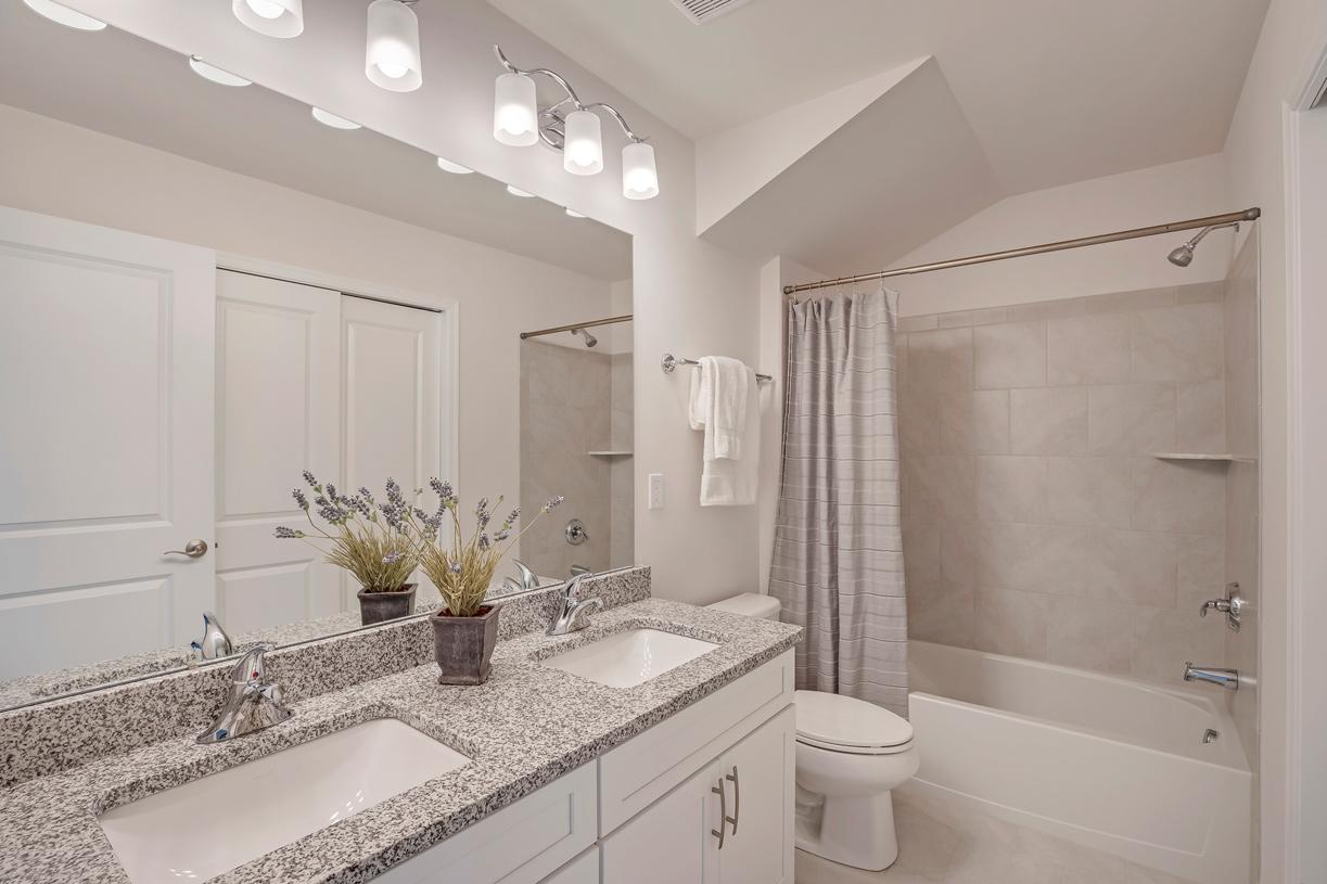 Secondary bathroom with dual-sink vanity