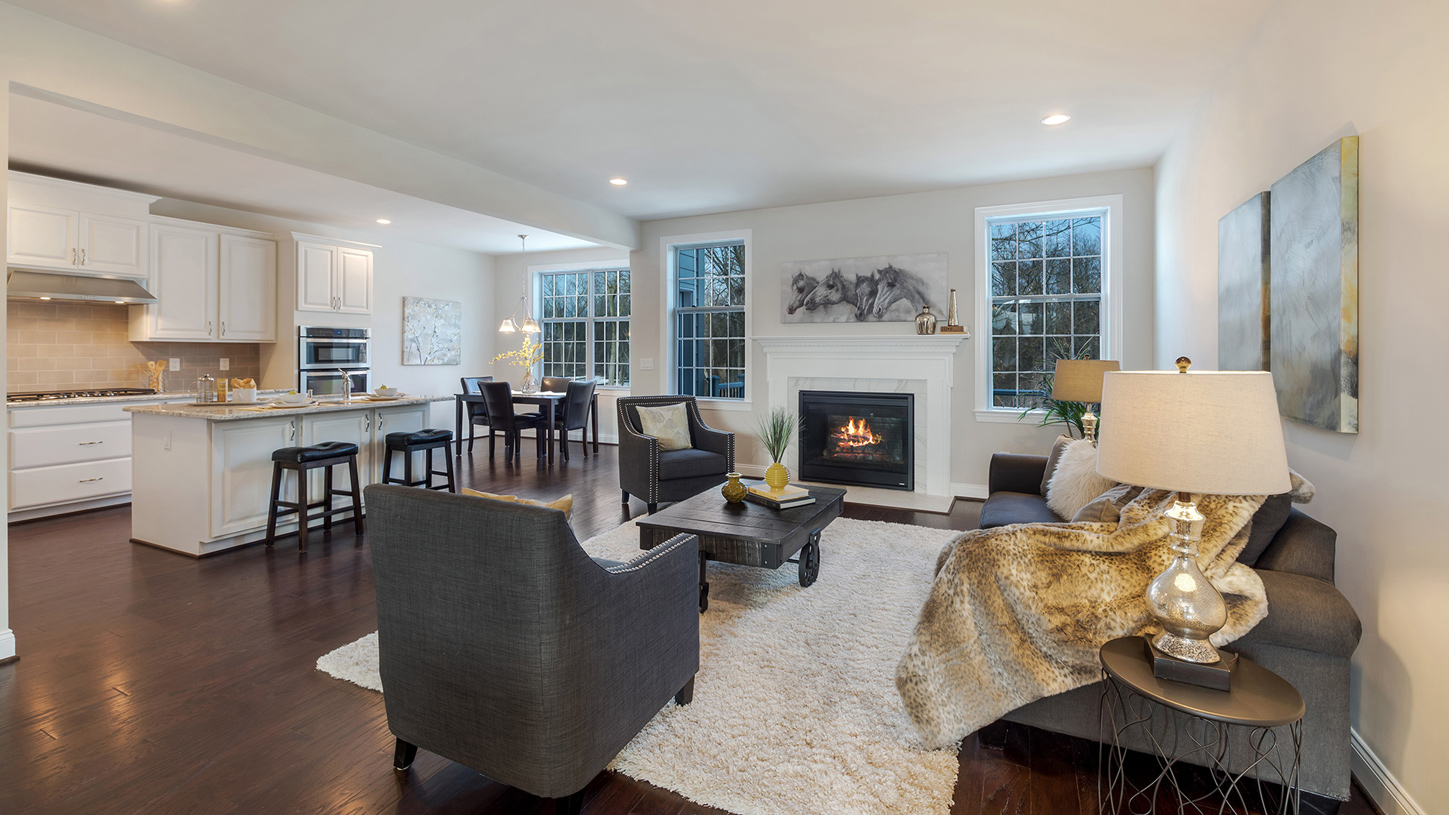 Kitchen island overlooks great room and casual dining area