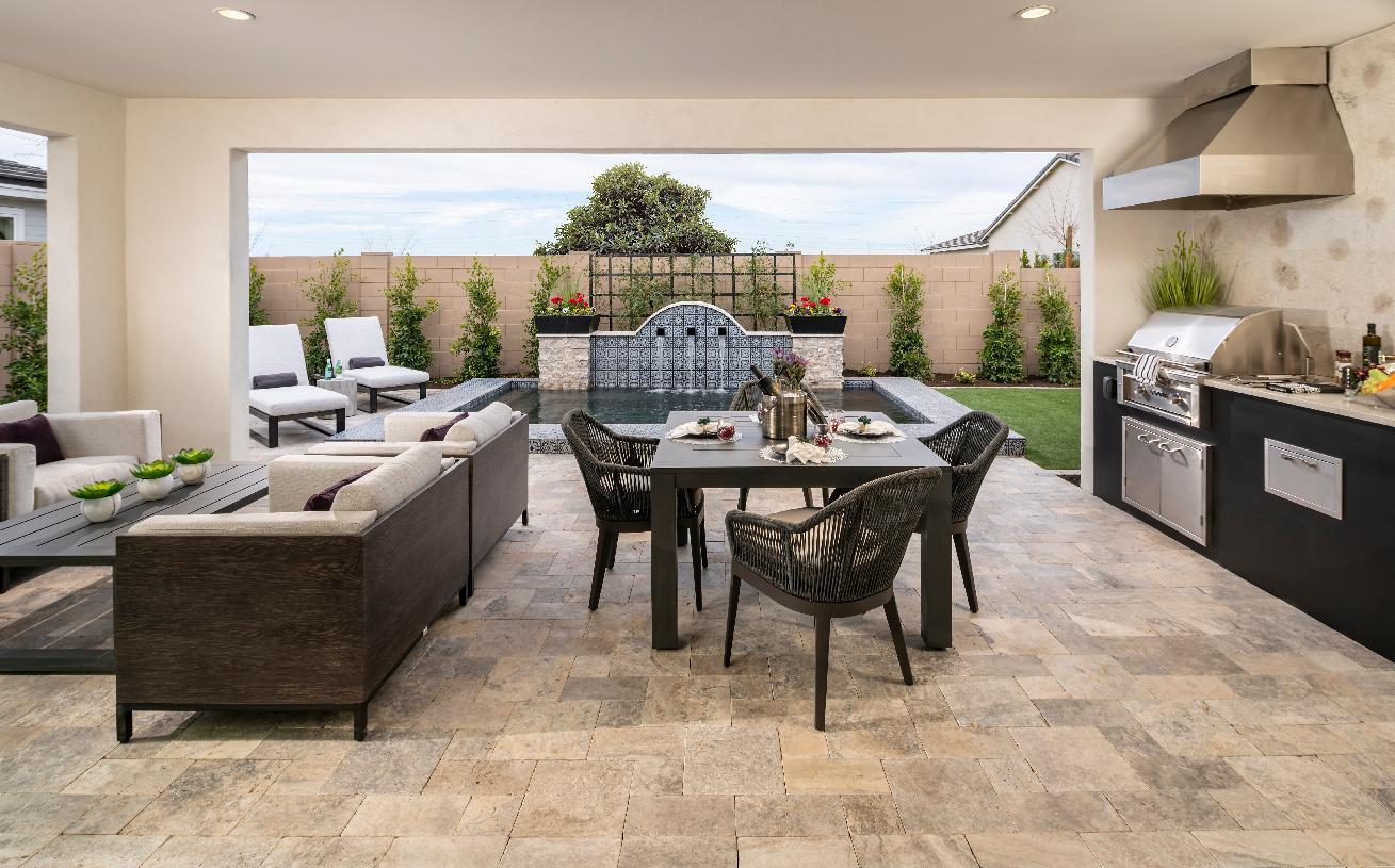 Covered patio with outdoor kitchen and dining area