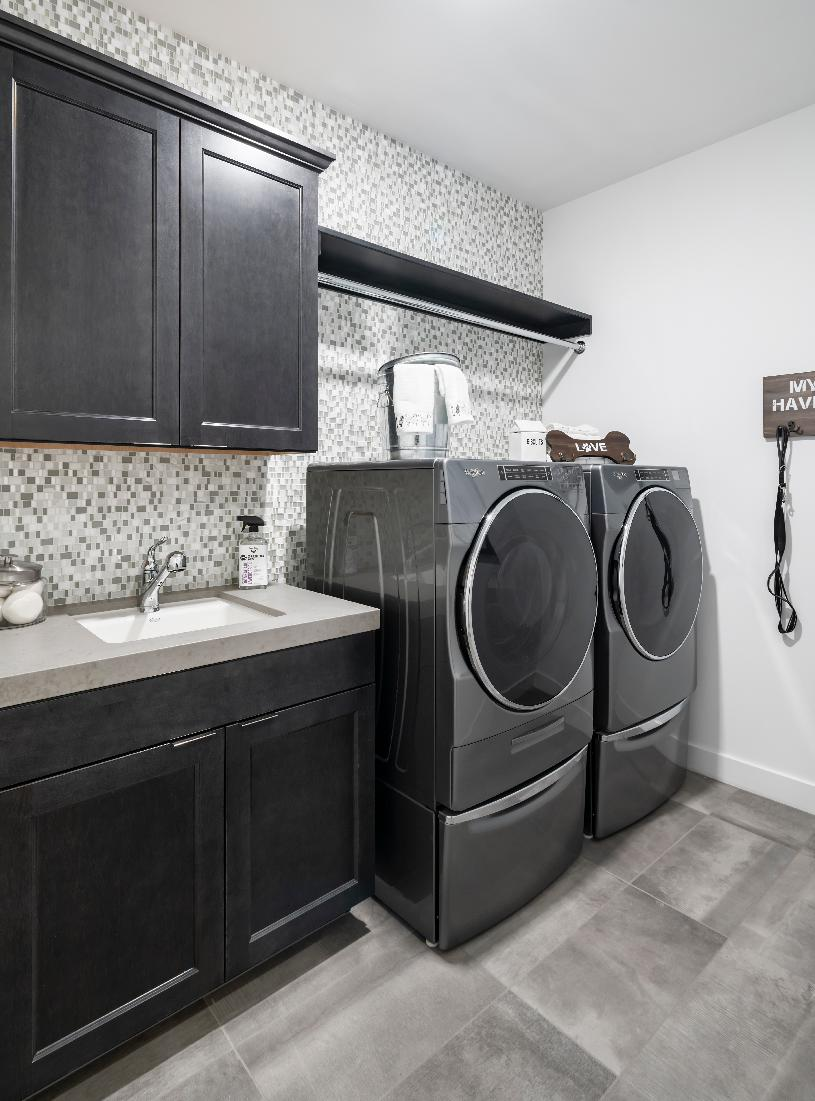 Roomy laundry room with sink and storage space