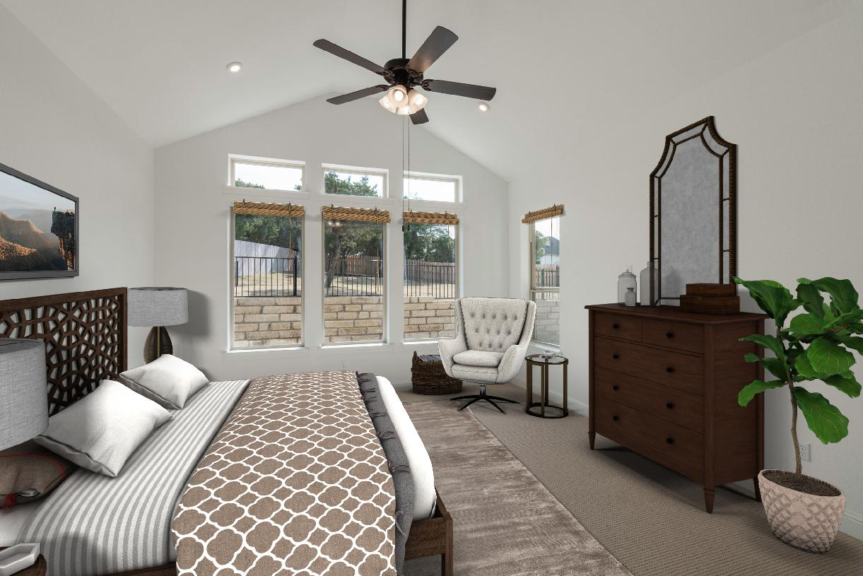 Bedroom suite is enhanced by a vaulted ceiling