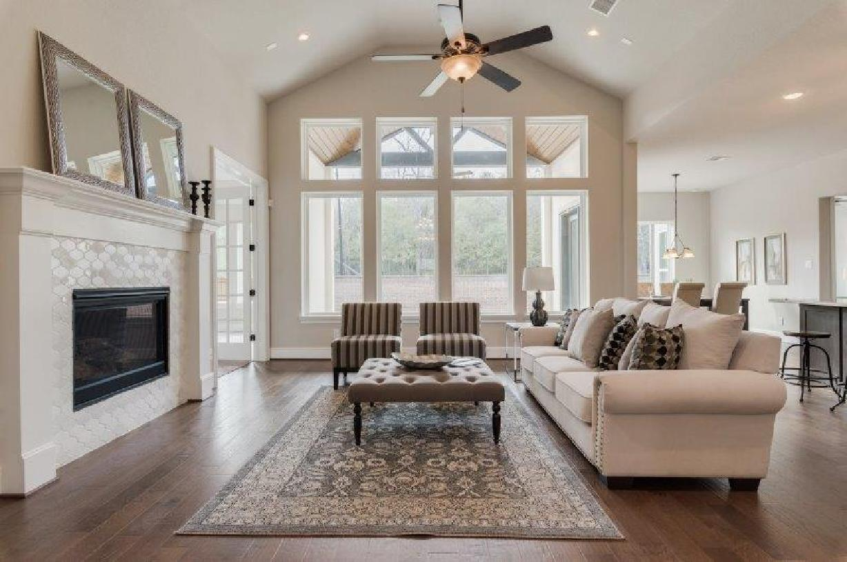 Beautiful vaulted ceiling unifies the impressive great room and covered patio