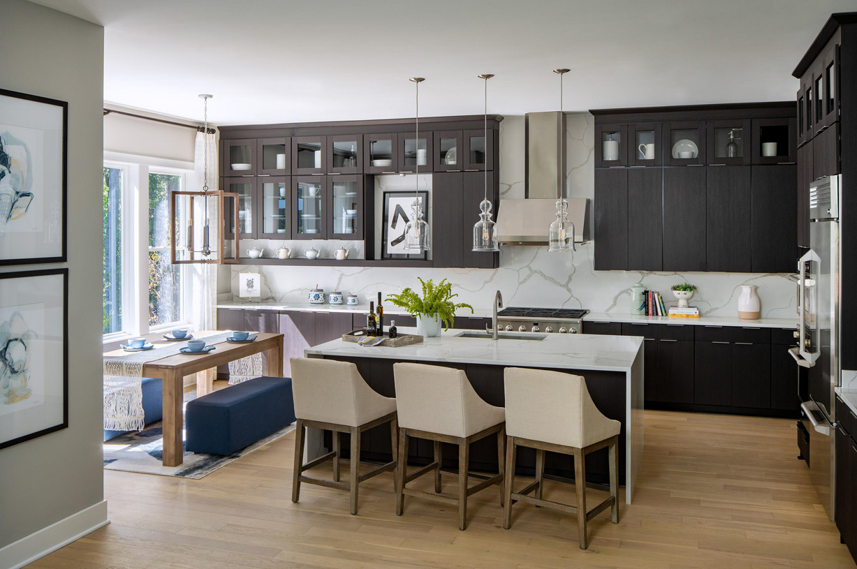 Large kitchen overlooks casual dining area