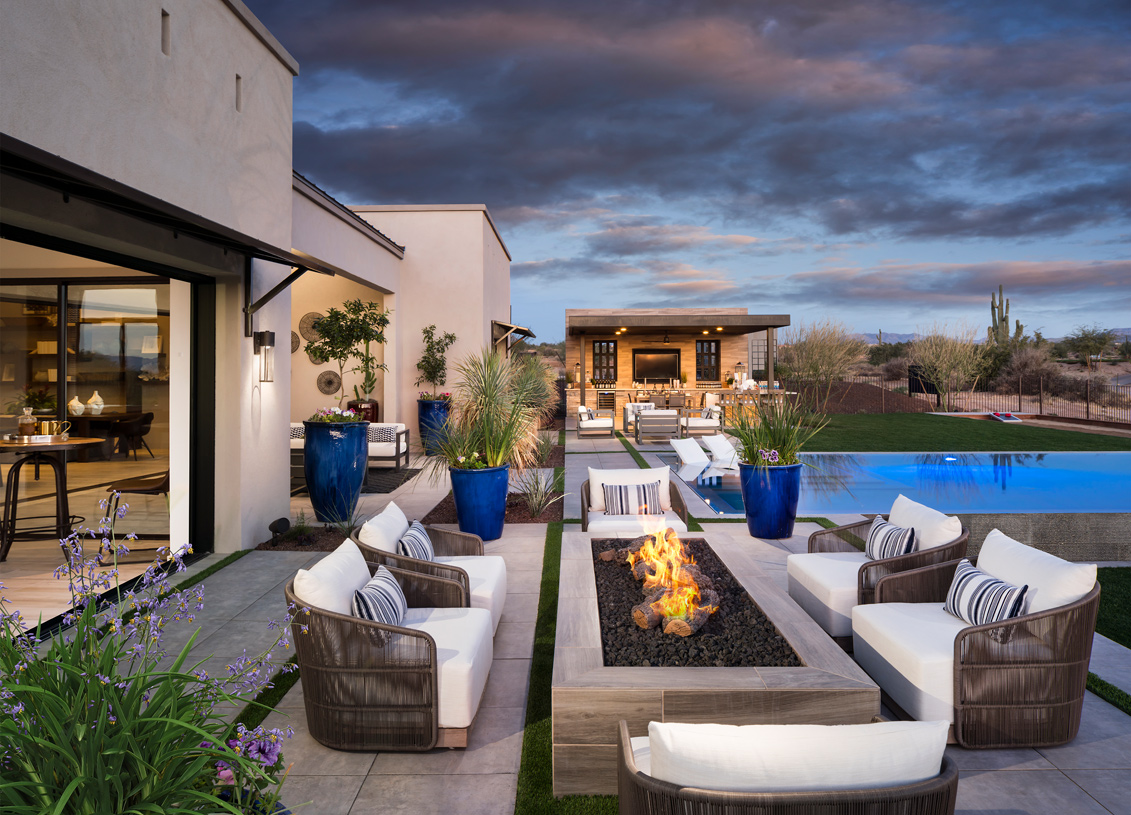 Serene outdoor gathering area with firepit and beautiful mountain views