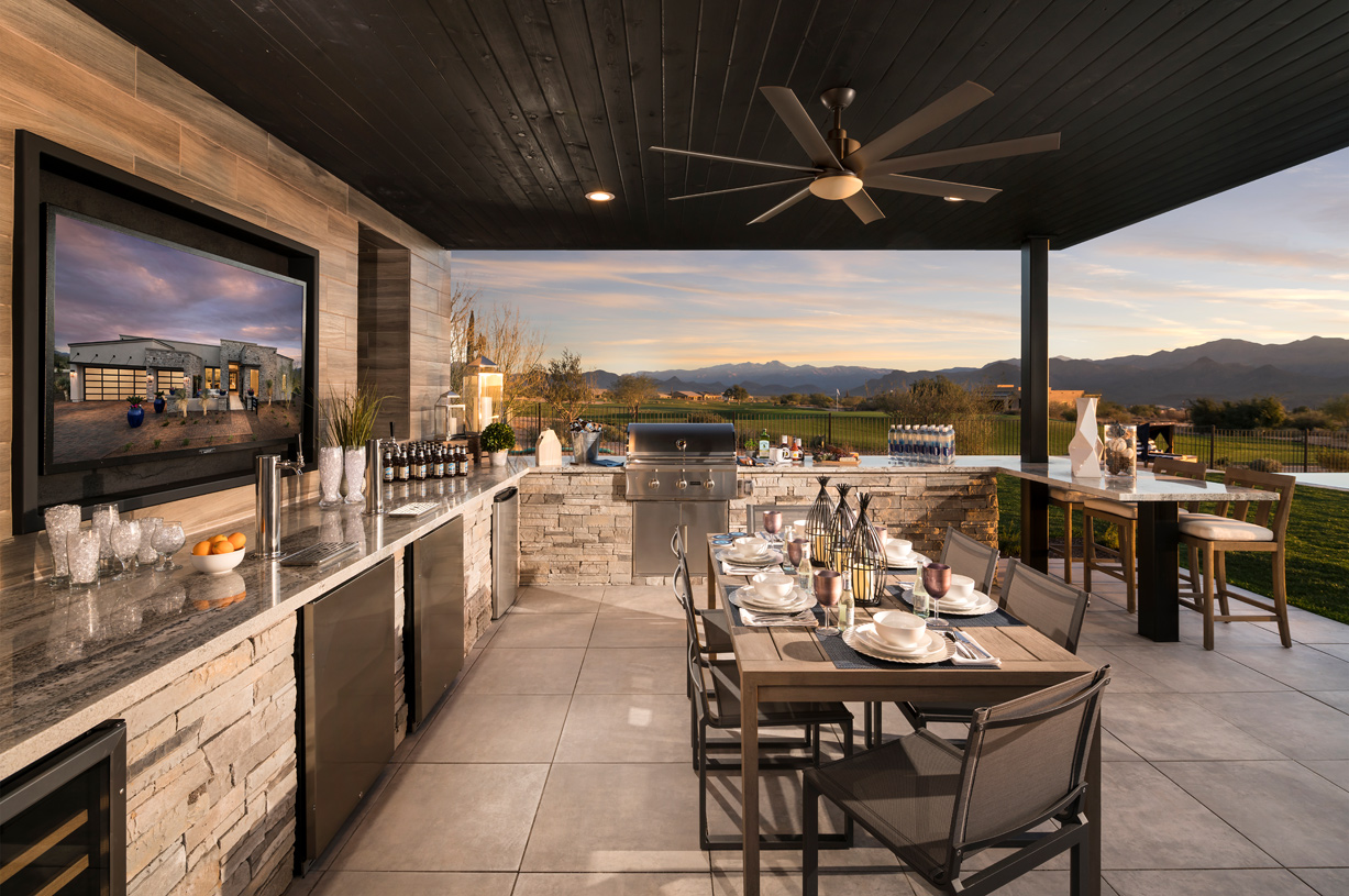 Outdoor kitchen with golf course and mountain views