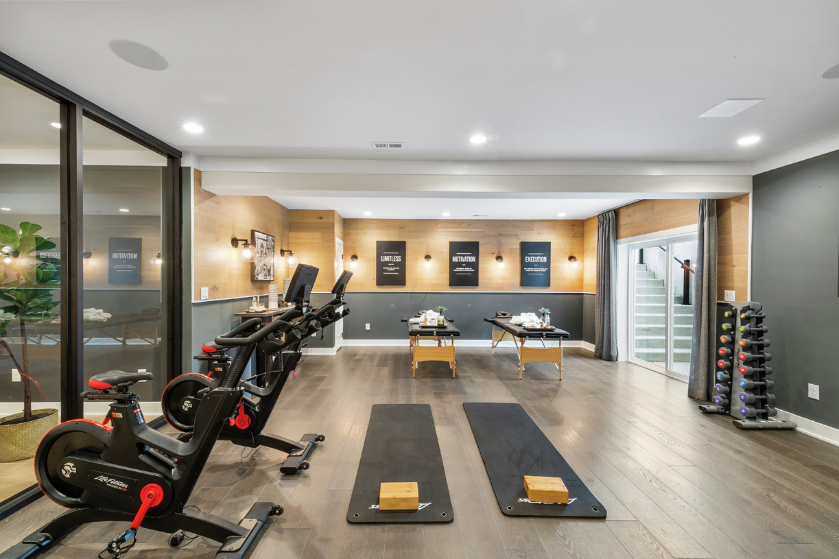 Finished basement featuring an in-home gym