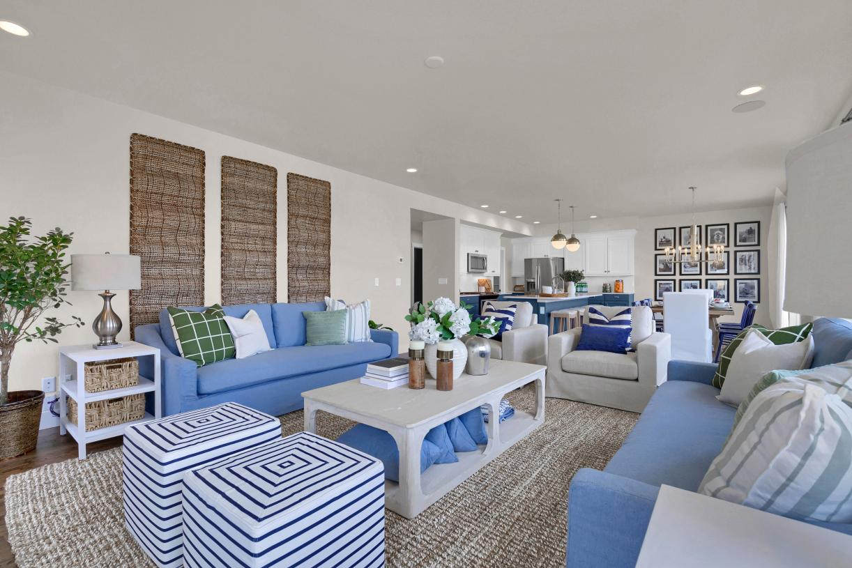The connected great room affords space for large furniture pieces placed around the gas fireplace