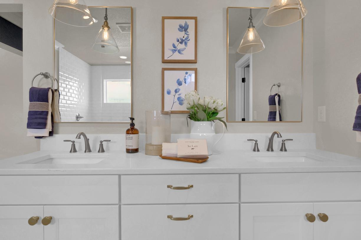 Enjoy your own space in the primary bathroom featuring a dual sink vanity
