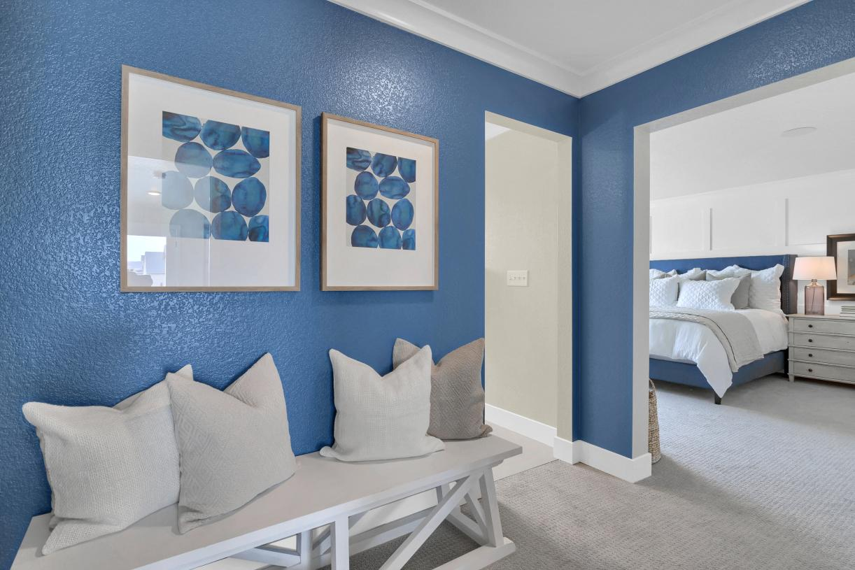 A welcoming entrance into the primary bedroom defines the secluded space