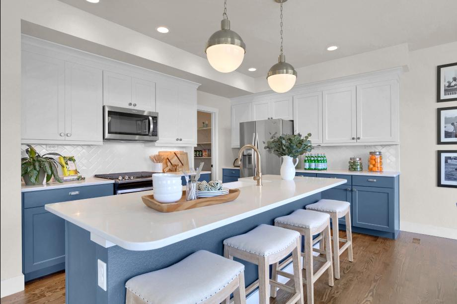 Spacious kitchen with a coveted corner walk-in pantry for ample storage