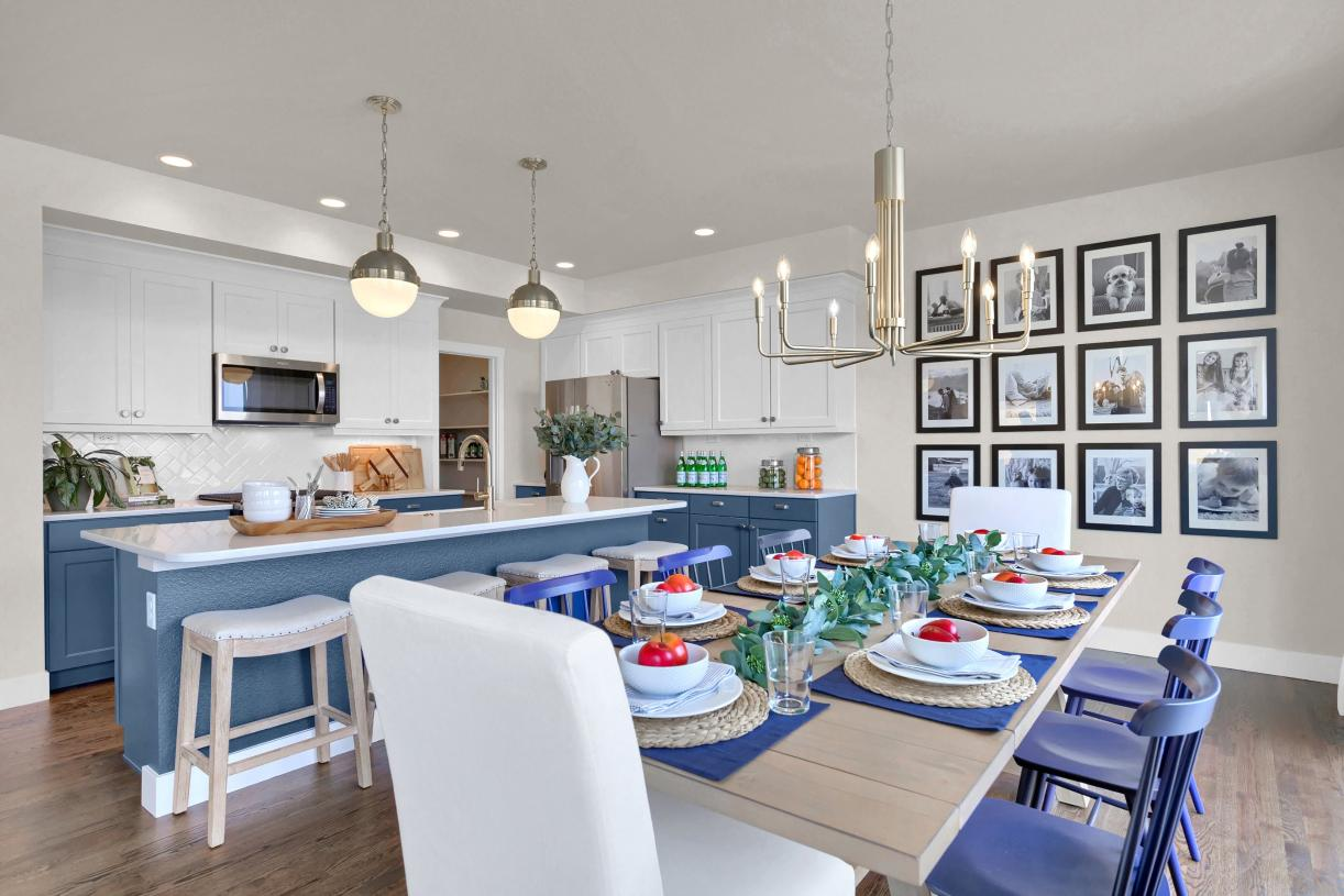 Hosting family dinners is seamless with the open flow of the kitchen and casual dining area