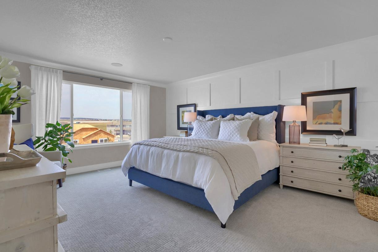 Escape the day in the primary bedroom with attached bathroom and large walk-in closet