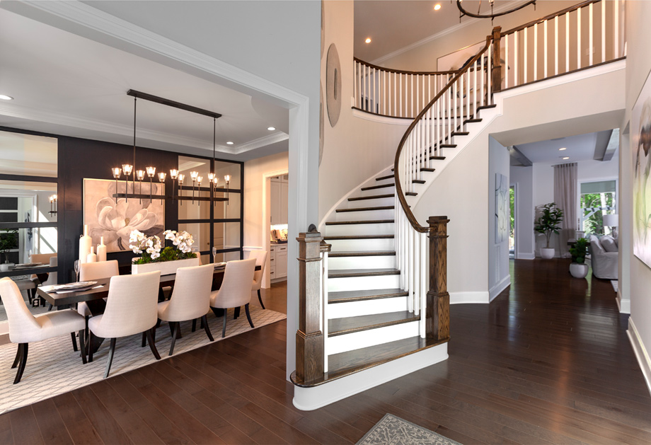 Curved staircase foyer