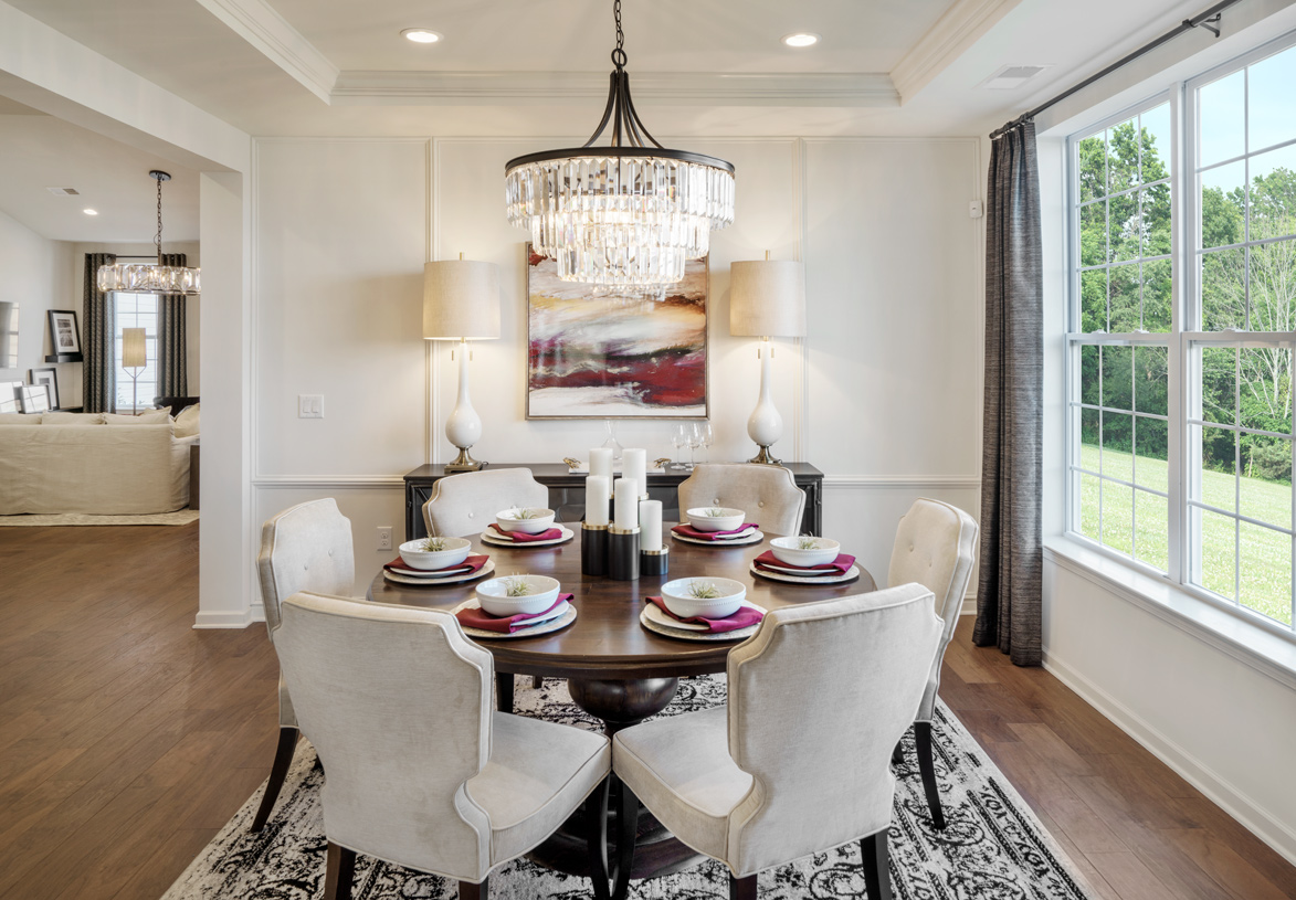 Dining room with stunning upscale lighting fixture