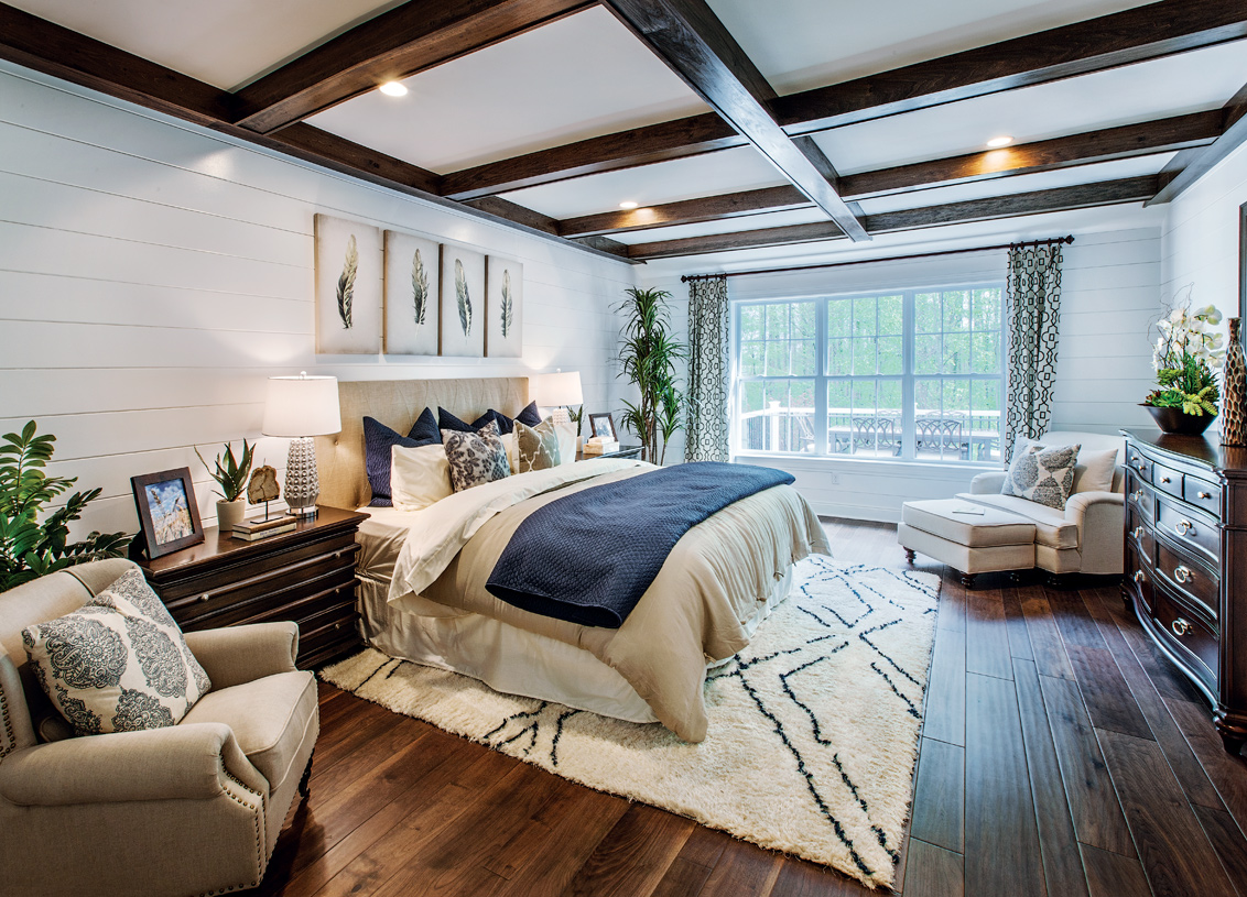 First-floor primary bedroom suite with two walk-in closets