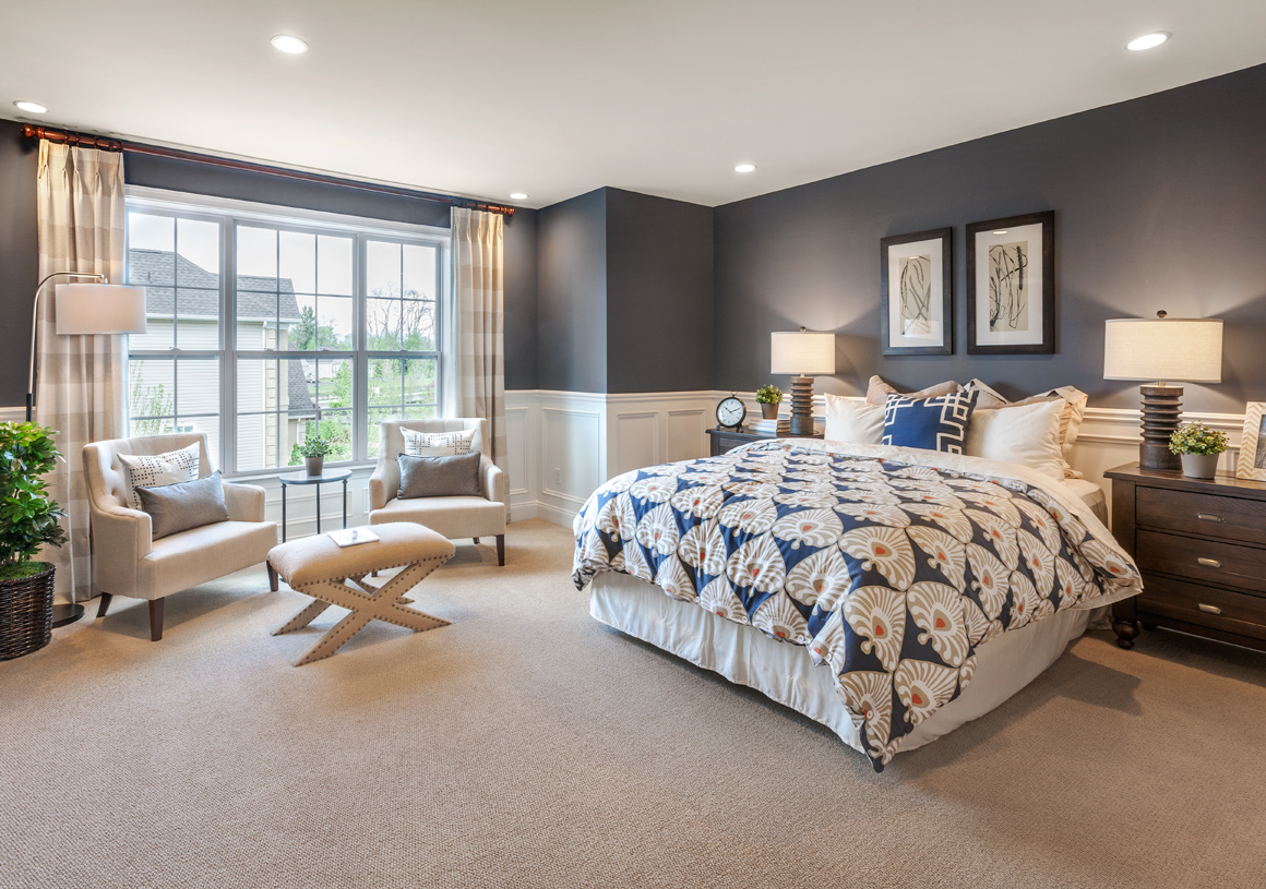 Primary bedroom suite with luxurious bathroom