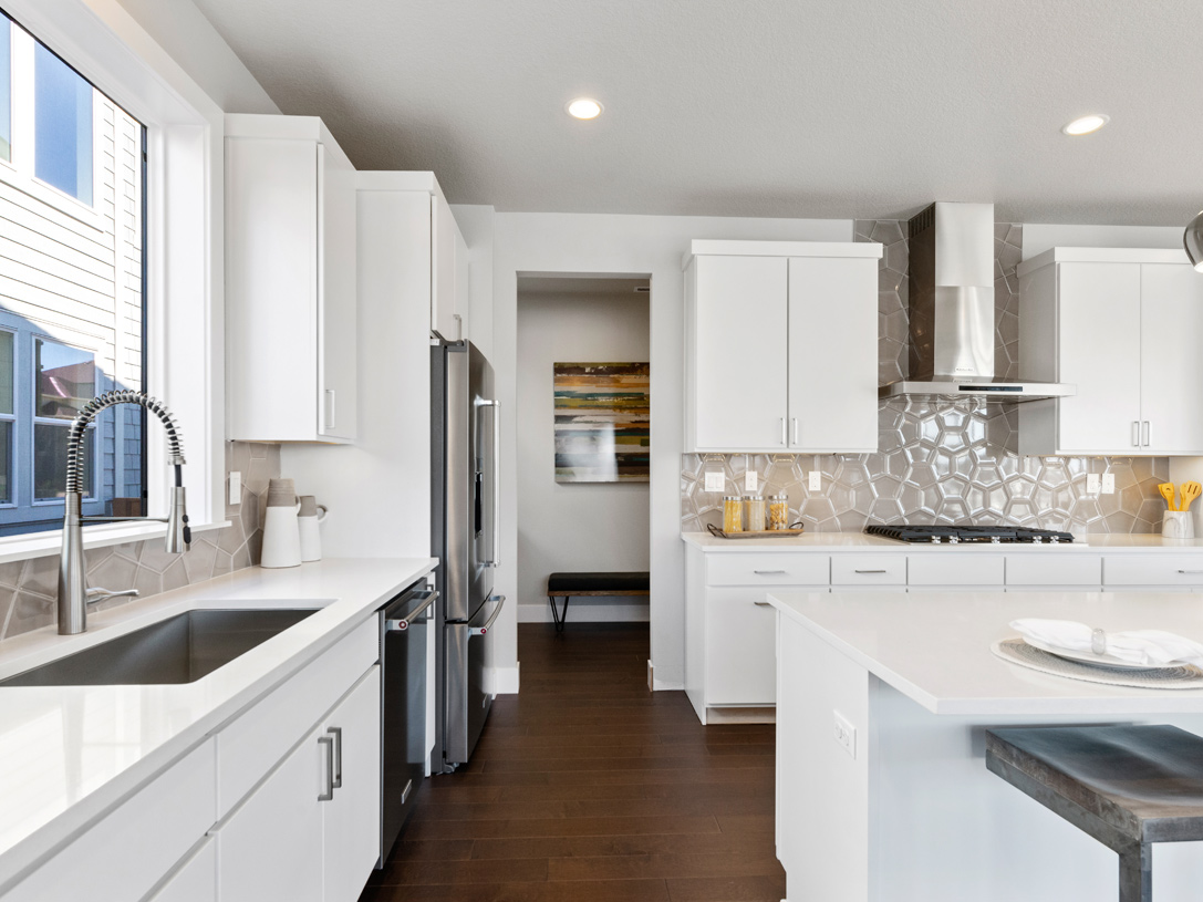 Well designed kitchen with drop zone and walk-in pantry behind
