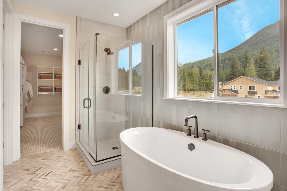 Primary bath with free-standing tub and walk-in closet