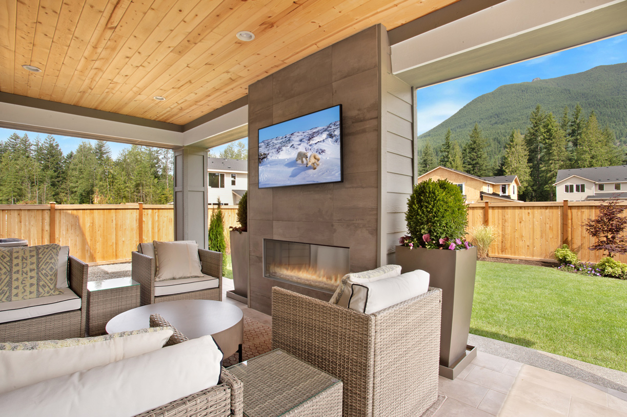Covered luxury outdoor living with gas fireplace