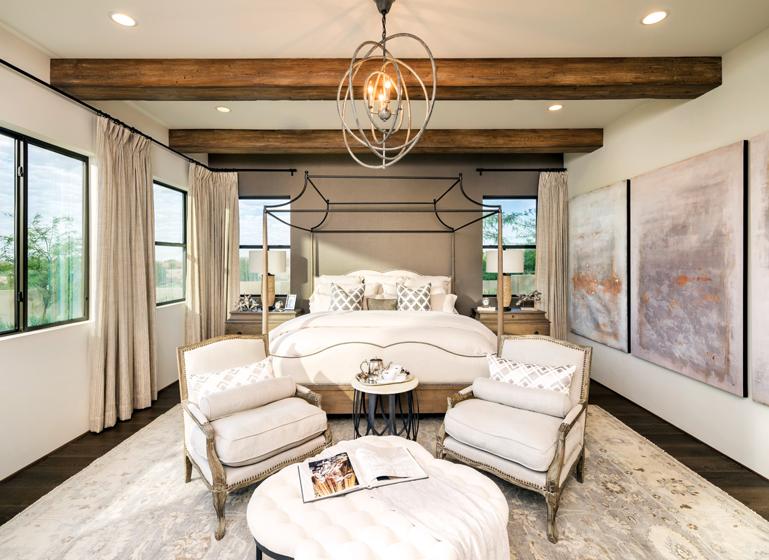 Palatial primary bedroom with gorgeous wood beams