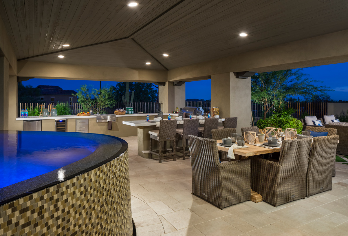 Outdoor kitchen and dining area in a serene desert setting