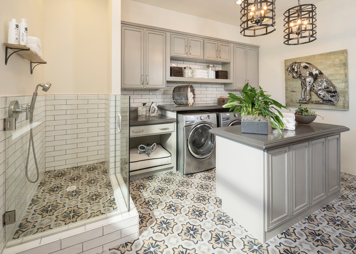 Well-proportioned laundry room with dog wash and ample storage