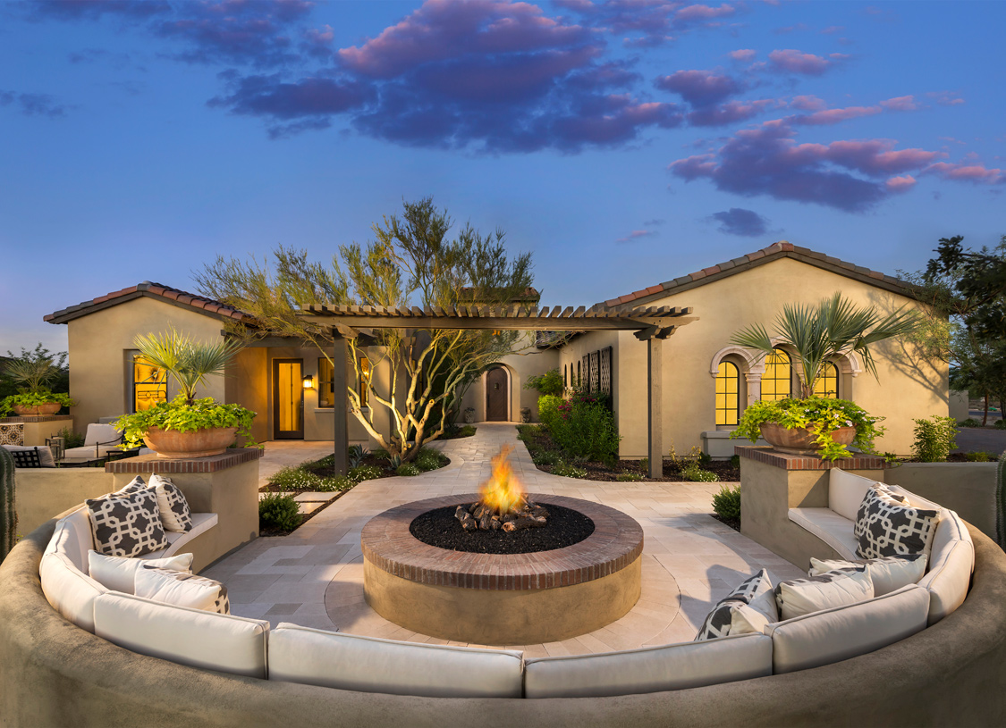 Welcoming courtyard entry with outdoor seating surrounding a firepit