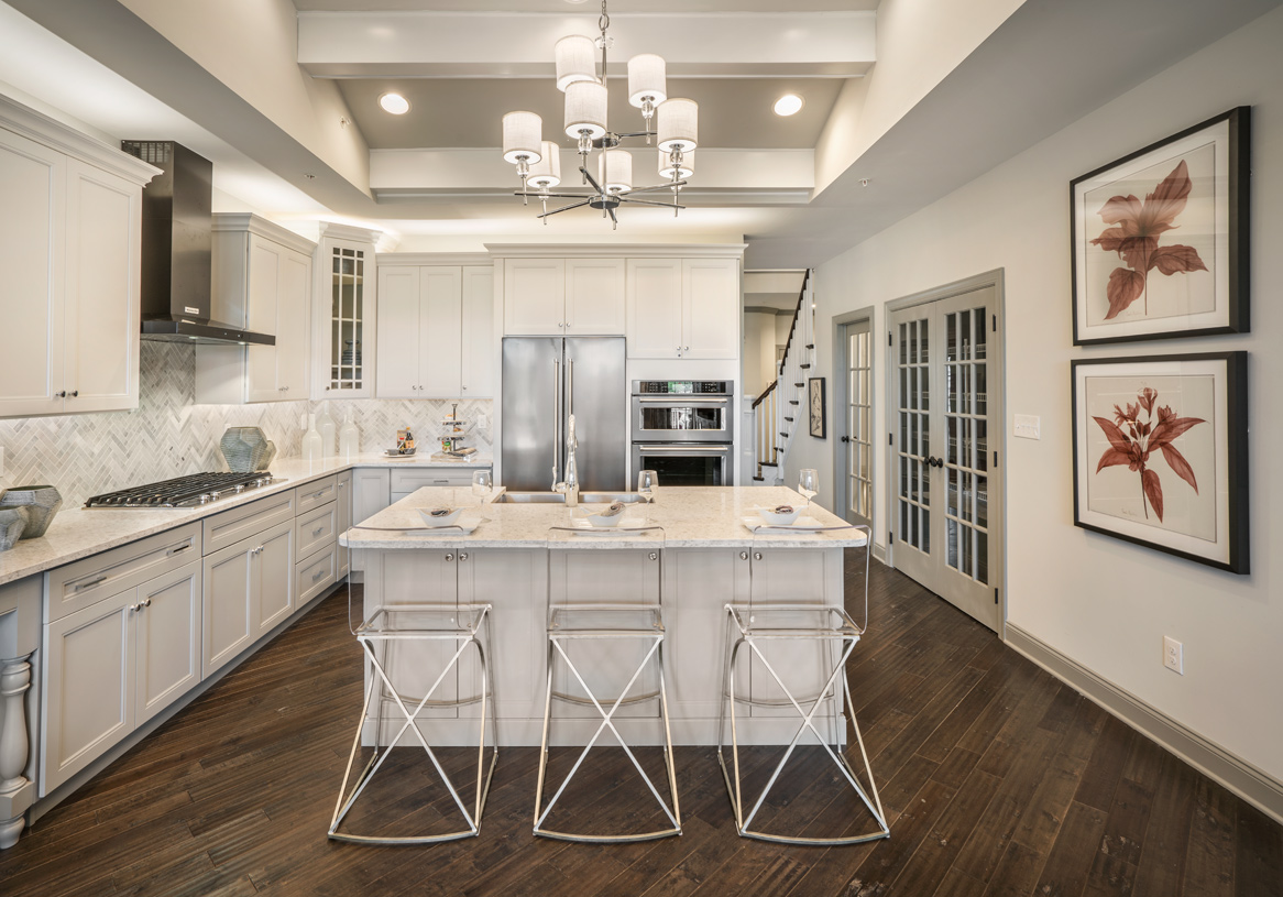 Well-appointed kitchen with large center island and granite countertops