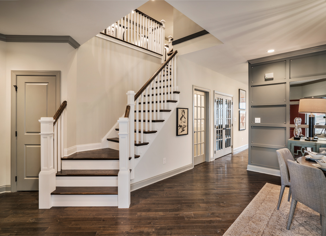 Foyer opens to an elegant staircase and formal dining room