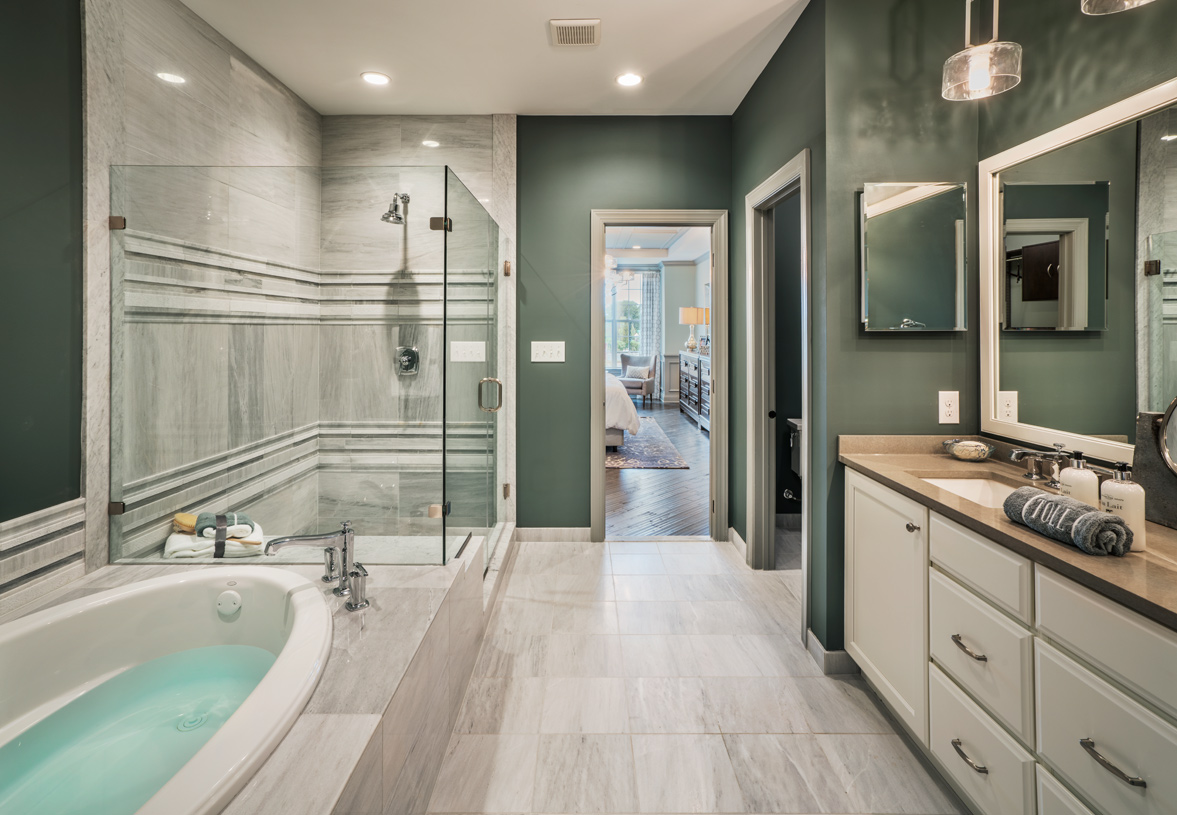 Spa-like primary bathroom with glass enclosed shower