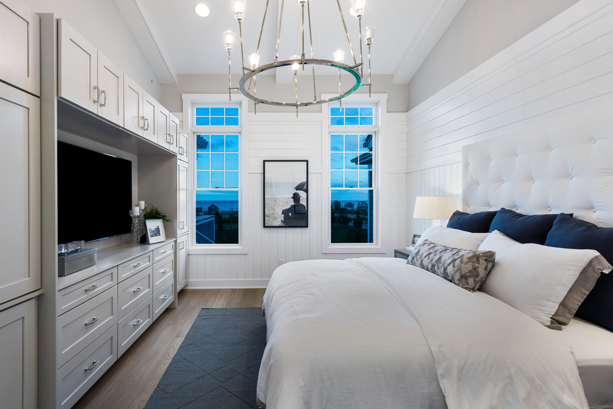 First-floor primary bedroom suite with private bath and walk-in closet