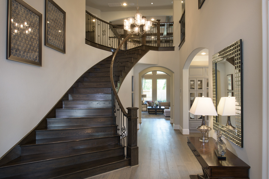 Welcoming two-story foyer with elegant curved staircase