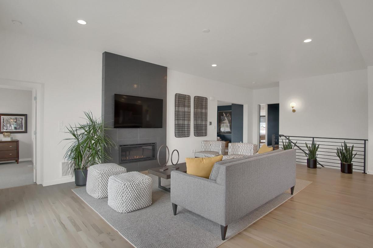 Cozy up to the fireplace in the great room or get work done in the flex space just around the corner