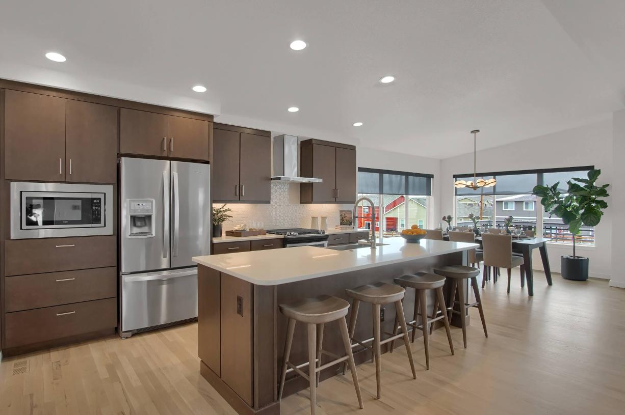 Open kitchen design with the casual dining area connected for easy entertaining