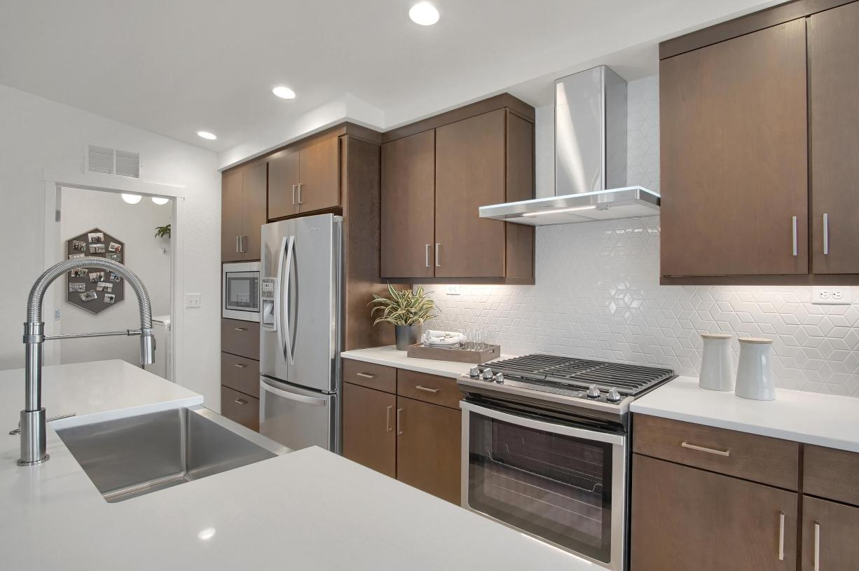 Spacious kitchen with stone countertops and stainless steel appliances