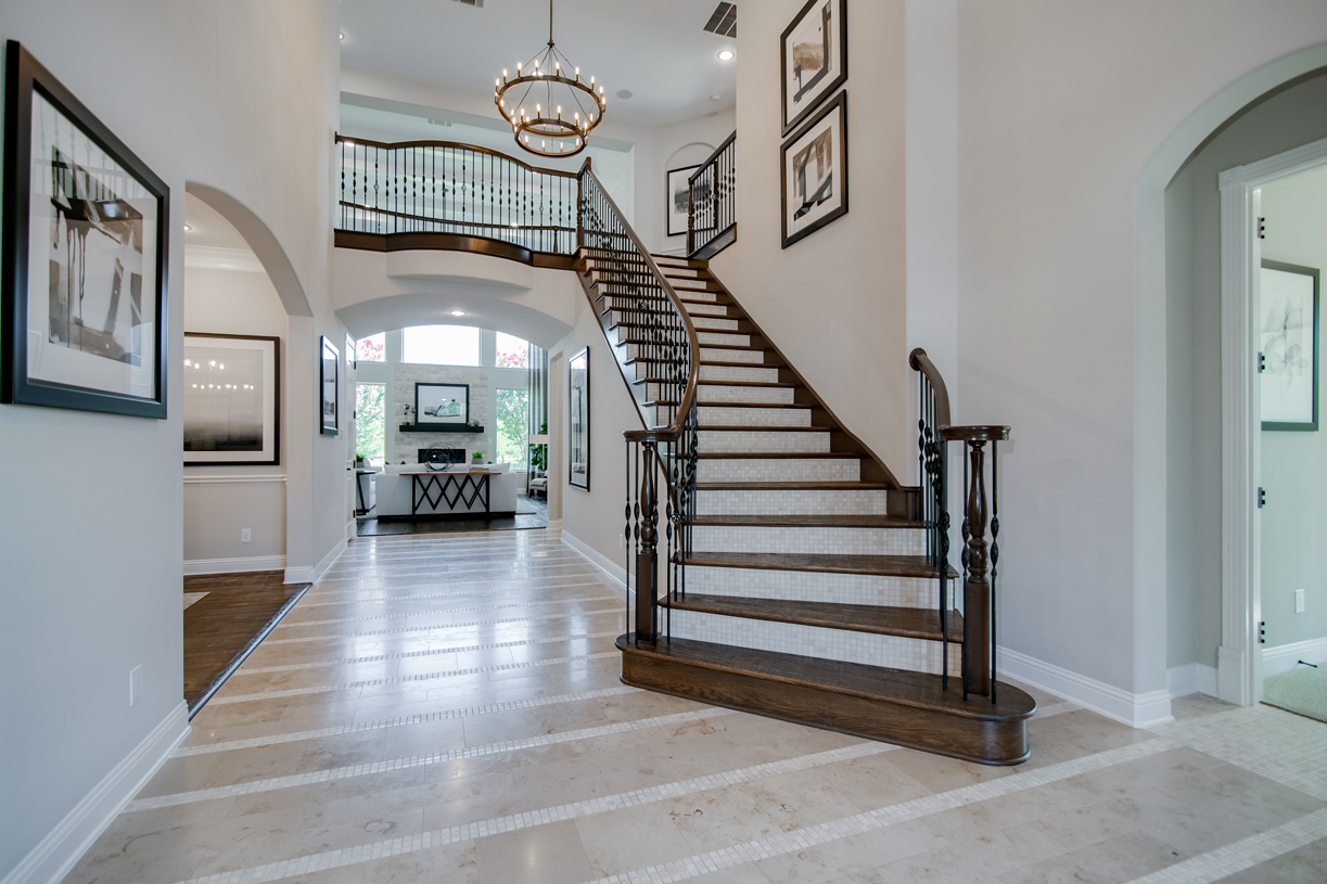 Welcoming two-story foyer with elegant staircase