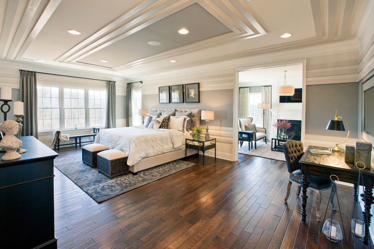 Spacious primary bedroom suite with sitting area and office nook