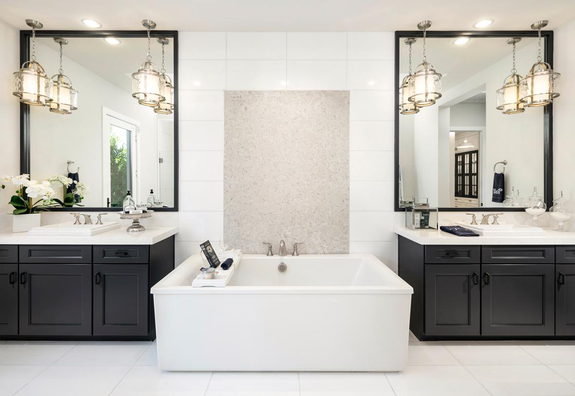 Lavish primary bathrooms with split dual-sink vanity and freestanding soaking tub