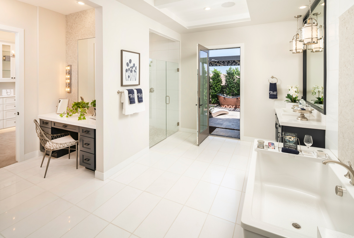 Large primary bathrooms with access to a secluded retreat