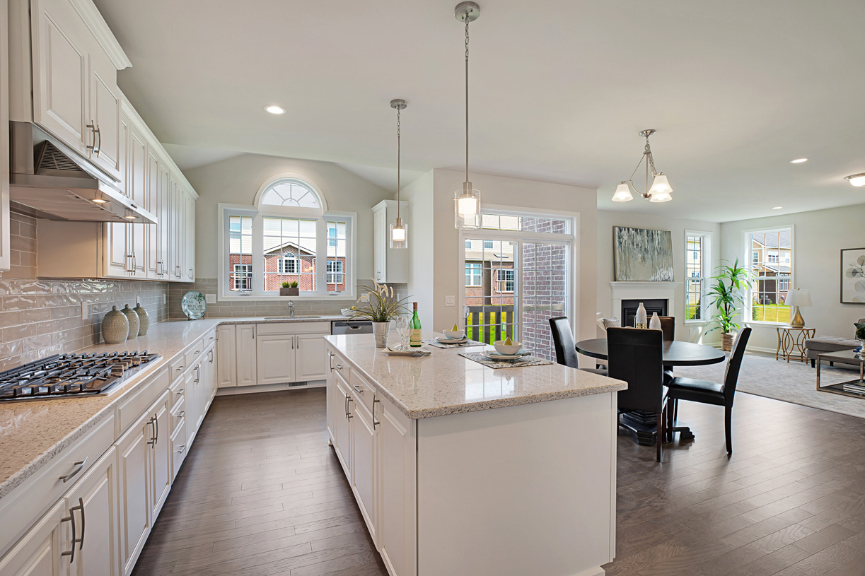 Gourmet kitchen and casual dining area open to great room, perfect for entertaining