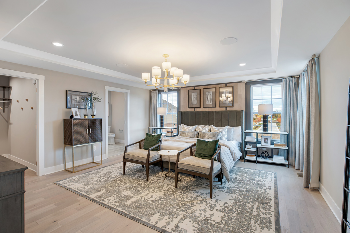 Luxurious primary bedroom suite with large walk-in closet