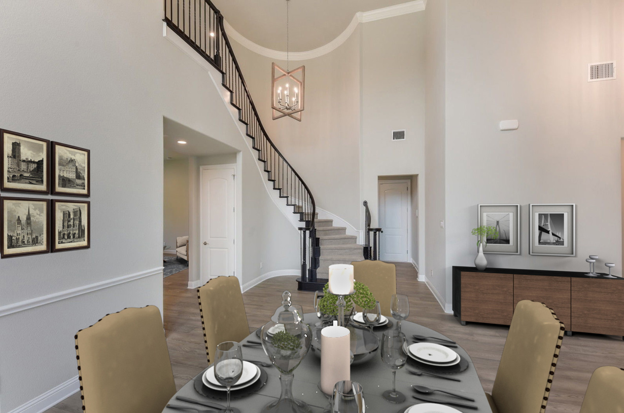 Breathtaking two-story foyer and formal dining room
